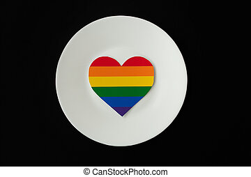rainbow heart on a white plate, black background