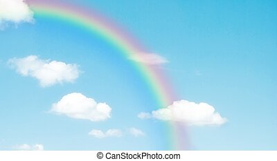 rainbow in the blue sky after the rain