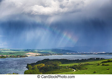 Rainbow in the cloudy sky