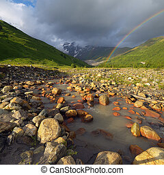 Rainbow in the mountains above the river