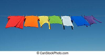 Rainbow laundry, bright shirts on a clothesline - Rainbow...