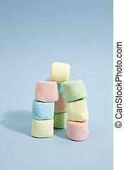 Rainbow marshmallow - tower of rainbow marshmallow on a...