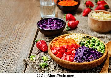 rainbow millet vegetable salad on dark wood background. ...