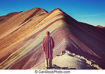 Rainbow mountain - Hiking scene in Vinicunca, Cusco Region,...