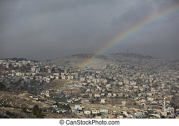 Rainbow on a view of old city and villages around Jerusalem