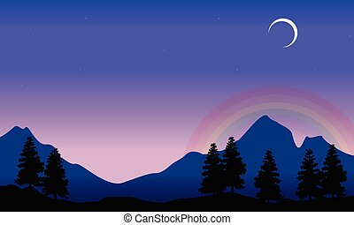 Rainbow on mountain scenery silhouettes