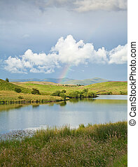 rainbow over a lake