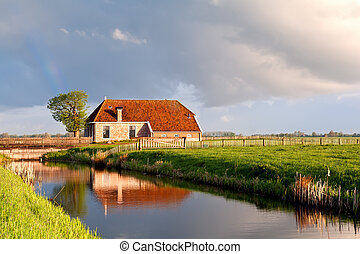 charming house by river in sunrise sunshine