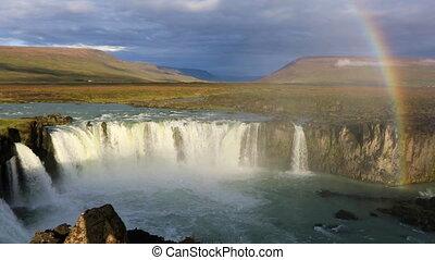 Rainbow over Godafoss waterfall in Iceland - The rainbow...