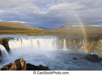 Rainbow over Godafoss waterfall in Iceland
