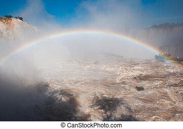 Rainbow over gorgeous waterfalls of Iguazu, Brazil
