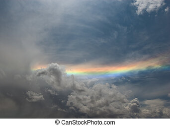 rainbow over grey cloudy sky