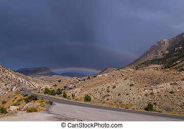 Rainbow over highway 14 leading to Bighorn National Forest