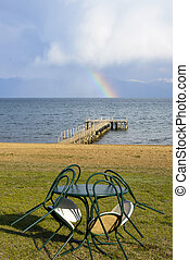rainbow over lake prespa in macedonia, image