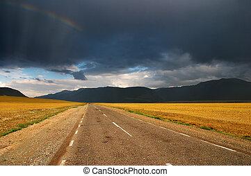 Rainbow over road