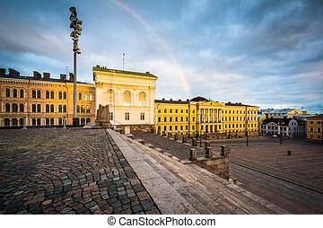 Rainbow over Senaatintori, Senate Square at sunset, in ...