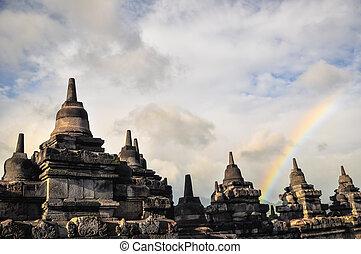 Rainbow over Stupa Buddist temple Borobudur complex in...