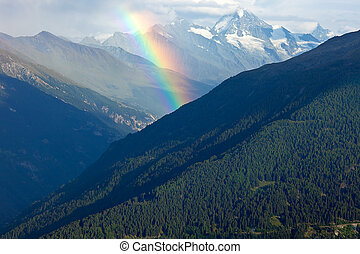 Rainbow over the alps.