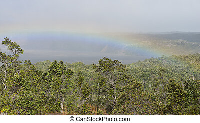 Rainbow over the crater in Volcanoes National Park, Big Island of Hawaii