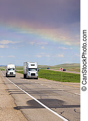 Rainbow over the highway in Saskatchewan