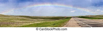 Rainbow over the highway in Saskatchewan