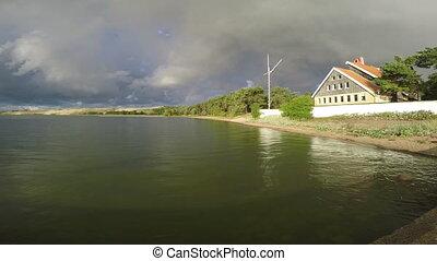 Rainbow over the house against cloudy sky - Rainbow over the...
