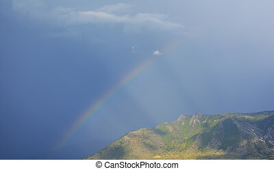 Rainbow over the mountain