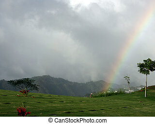 Rainbow over the National Memorial Cemetery of the Pacific in Punchbowl on Oahu, Hawaii.