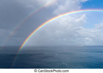Rainbow over the ocean.
