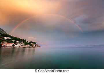 Rainbow over the Small Village in Omis Riviera after the ...