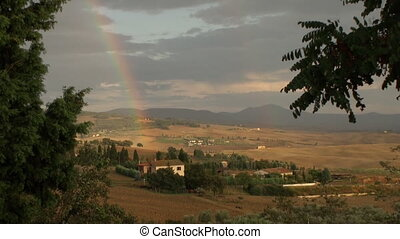 Rainbow over the Val d'Orcia in Tuscany, Italy
