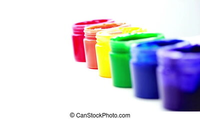 Rainbow paint pots in a line for gay pride on white...