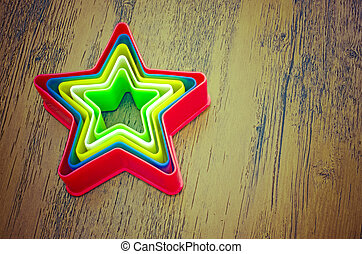 Rainbow Plastic Stars on Wooden Bac