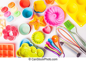 Rainbow silicone confectionery untersils on a white ...