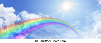Wide blue sky banner with rainbow arcing across and bright sunburst