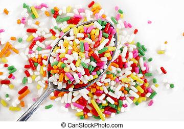 rainbow sprinkles in spoon