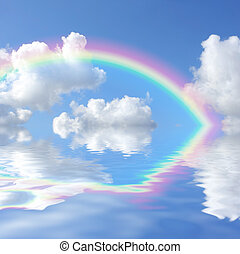 Rainbow - Abstract of a blue sky with cumulus clouds and a...