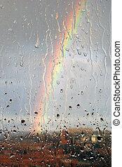 Rainbow through the wet glass