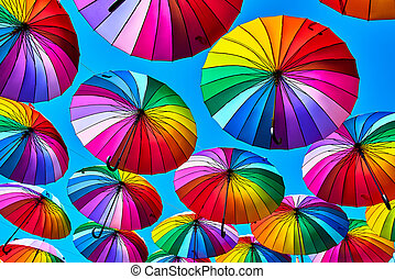 Rainbow umbrella on sky background. Many colorful umbrellas. umbrella street decoration
