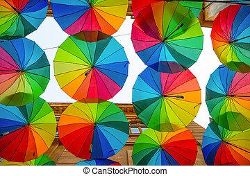 Rainbow umbrellas roof street in Victory Passage , Bucharest