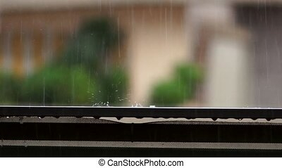 raindrop falling on balcony balustrade and splashes water...