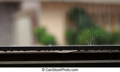 raindrop falling on balcony balustrade and splashes water on...
