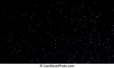 Raindrops - Night shower in the spotlight. Slow Motion at a...