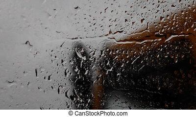 raindrops on a car windshield e