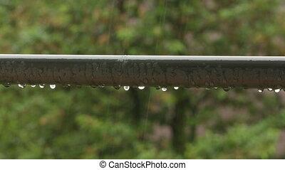 Raindrops on a Handrail - Raindrops on a handrail against a...
