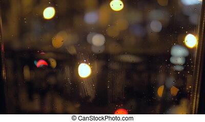 Raindrops on a window at night