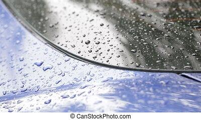 Raindrops on car closeup