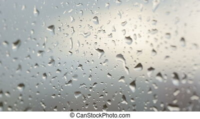 Raindrops on glass in closeup