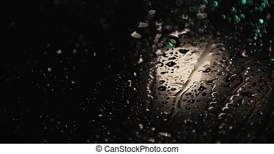 raindrops on the glass at night