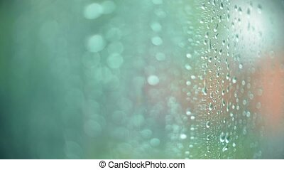 Raindrops on the window on a rainy day. Close-up shallow...